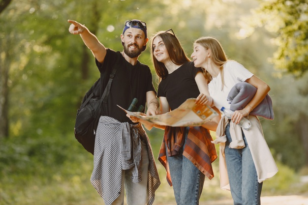 adventure-travel-tourism-hike-people-concept-group-smiling-friends-forest_1157-44388